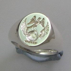 Eagle standing on atlas crest ring